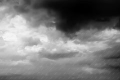 Thunder clouds raining background in Black and White. Thunder clouds raining background in Black and White for graphic use Royalty Free Stock Photos