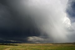 Thunder clouds roll in across Big Sky Country, Montana stock photos