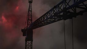 Thunder and crane Video. Black animated Crane against animated red thunder and dark clouds background stock video footage