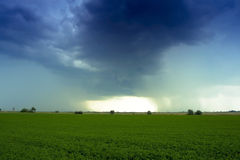 Thunder in the field. Summer thunder cloud in the field stock image