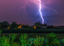 Thunder hitting house in the village Royalty Free Stock Photo