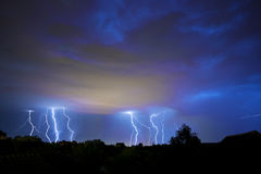 Thunder, lightning and storm in dark night sky Royalty Free Stock Photo