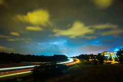Thunder and lightning storm weather during evening traffic commu Stock Photos