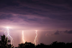 Thunder lightnings and storm on the dark sky Stock Image