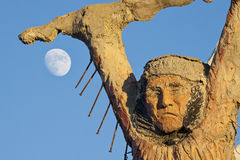 Thunder Mountain Statue and Moon Stock Image