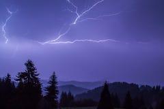 Thunder over the mountain. Thunderstorm over a mountain range near Pamporovo, Bulgaria royalty free stock photos