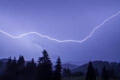 Thunder over the mountain. Thunderstorm over a mountain range near Pamporovo, Bulgaria royalty free stock photography