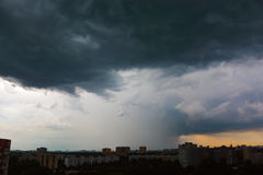 Thunder sky. And clouds over city, coming storm stock photo