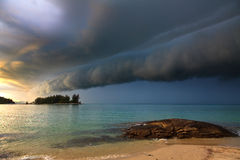 Thunder storm approaching the beach. Thunder storm with roll cloud approaching the tropical beach Royalty Free Stock Photos