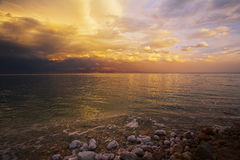 The thunder-storm on the Dead Sea. Improbable light effects during a spring thunder-storm on the Dead Sea Stock Photo