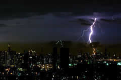 Thunder storm lighting bolt on the horizontal sky and city scape Stock Photos