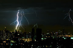 Thunder storm lighting bolt on the horizontal sky and city scape Stock Images