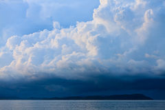 Thunder storm with rain lit by the sun. At a lake Stock Images