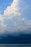 Thunder storm with rain lit by the sun Stock Photo