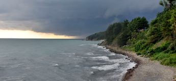 Thunder storm with rain lit. Thunder storm with roll cloud approaching the beach Royalty Free Stock Photography