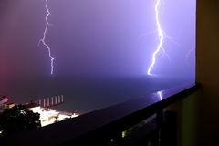 Thunder lightning strikes in the sea. During the summer rain stock photos