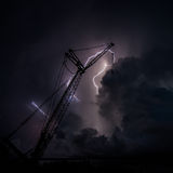 Thunder struck crane. Thunder storm at construction site stock photography
