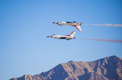 Thunderbird. LAS VEGAS - NOVEMBER 11: Thunderbird F-16 Aircrafts performing in an air show on November 11, 2012 in Las Vegas,USA. The Thunderbirds are the air royalty free stock photography