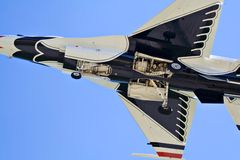 Thunderbird F16. An extreme closeup of the under belly of a Thunderbird F16 coming in for a landing stock images