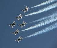 Thunderbirds flyby with smoke. Thunderbirds aerobatic team perfoms formation flyby in f16 fighter jets with smoke Royalty Free Stock Photos