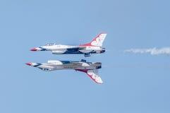 Thunderbirds perform high skill manuever Royalty Free Stock Photography