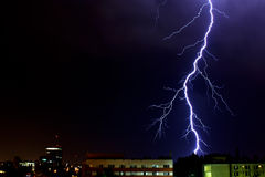 Perfect thunderbolt in a dark stormy night. A beautiful thunderbolt caught in a lightning storm, in a summer night, in Bucharest, Romania Royalty Free Stock Image