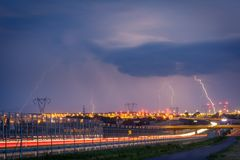 Lightnings on lublin during one of the storms in 2017. Thunderbolt - in meteorology a very strong electrostatic discharge in the atmosphere arising naturally Stock Image