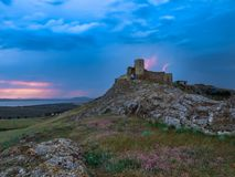Thunderbolts,lightning on a cloudy evening blue sky over old Enisala stronghold,citadel Stock Photography