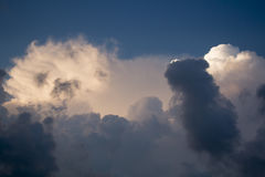 Thundercloud on a background of blue sky. Stock Photo