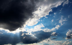 Thundercloud. The sun hid behind a big black cloud royalty free stock photography