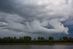 Thundercloud unusual form over the river Royalty Free Stock Images