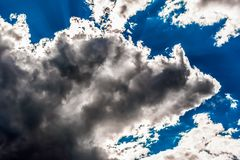 Cumulus clouds in the blue sky stock photo