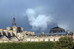 Thunderclouds over the Louvre Palace. (Richelieu Wing) seen from the Arc de Triomphe du Carrousel (triumphal arch) in Paris, France Royalty Free Stock Photography