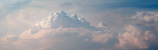 Thunderclouds. soft sunlight colored clouds. Storm clouds panorama. change of summer weather, sunlight-colored cumulus clouds. dramatic mood stock photos