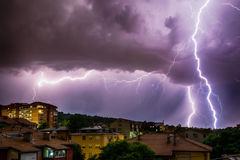 Thunderhead and Lightning Over City.  Royalty Free Stock Photography
