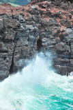 Thunderous waves splashing on cliffs Stock Image