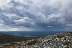 Thunderstorm approaching Fell Pallastunturi. Thunderstorm with lightning and heavy rain approaching Fell Pallastunturi in Finnish Lapland stock photography