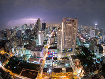 Thunderstorm Bangkok City View (fisheye) Thailand. Thunderstorm View over Bangkok City Skyline in Thailand, Asia with Lightning and Street Traffic at Night in Royalty Free Stock Photos