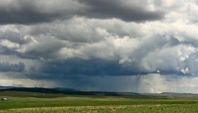 Thunderstorm. A thunderstorm brewing across the plains stock photos