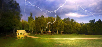 Thunderstorm in Bubnyshche. Near the rocks Dovbush forest, came the storm and strong wind storm with thunder and lightning shakes the trees. heavy rain will Stock Photos