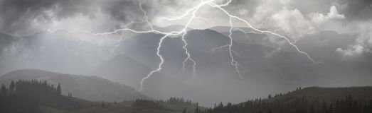 Thunderstorm in the Carpathians. A powerful dangerous natural phenomenon in the mountains of thunderstorm with electric lightning strike, bright flashes during a stock images