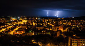 Thunderstorm in the city. Flashes over the city during a big summer thunderstorm Royalty Free Stock Photo