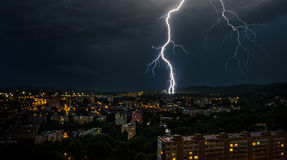 Thunderstorm in the city. Flashes over the city during a big summer thunderstorm Royalty Free Stock Photos