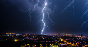 Thunderstorm in the city. Flashes over the city during a big summer thunderstorm Stock Photography