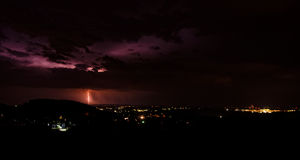 Thunderstorm in the city. Flashes over the city during a big summer thunderstorm Stock Photo