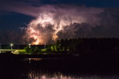 Thunderstorm cloud early in the morning, in summer before sunrise royalty free stock image