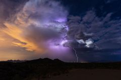 Thunderstorm cloud and lightning. Thunderstorm cumulonimbus cloud with lightning bolt strike and rain during the summer monsoon royalty free stock photography