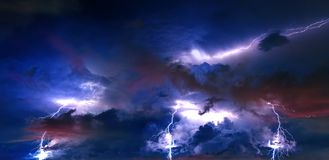 Thunderstorm clouds with lightning at night.  Royalty Free Stock Images