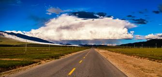 Thunderstorm Clouds over the Road.  Stock Images