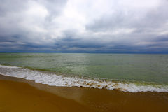 Thunderstorm clouds over sea. Landscape with thunderstorm over sea Royalty Free Stock Photos